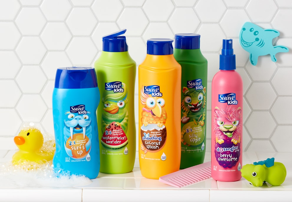 Family of Suave Kids® products in a tiled bathroom next to a comb and children's bath toys