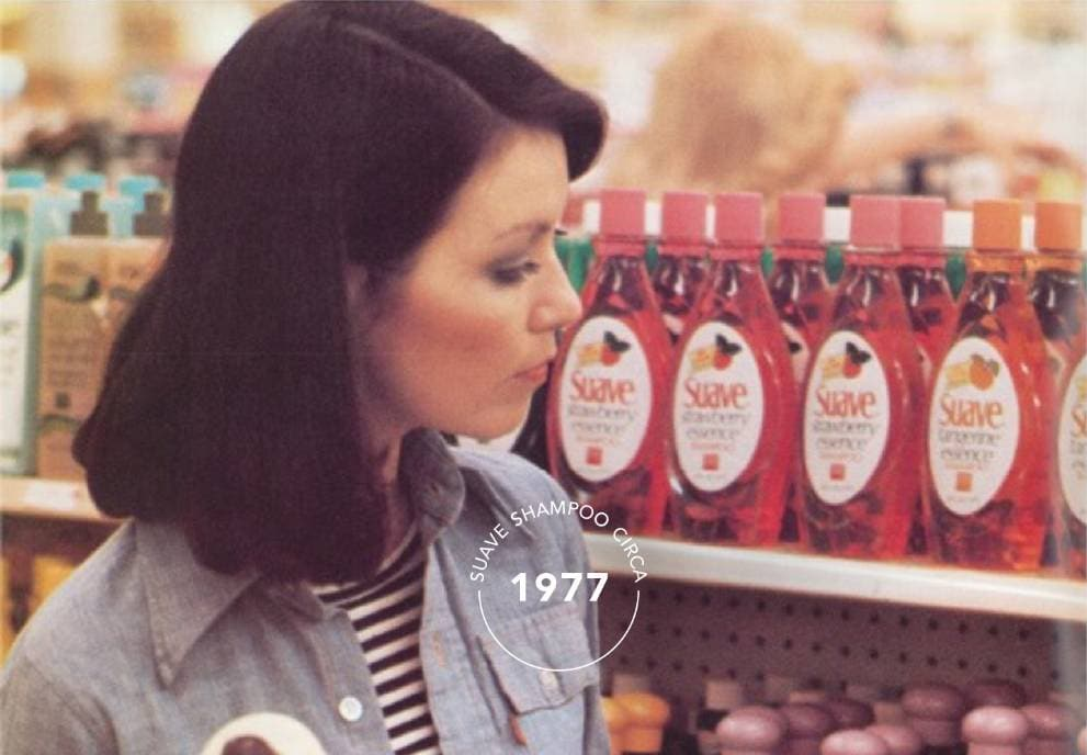 Woman in a shopping aisle with Suave® products from 1977